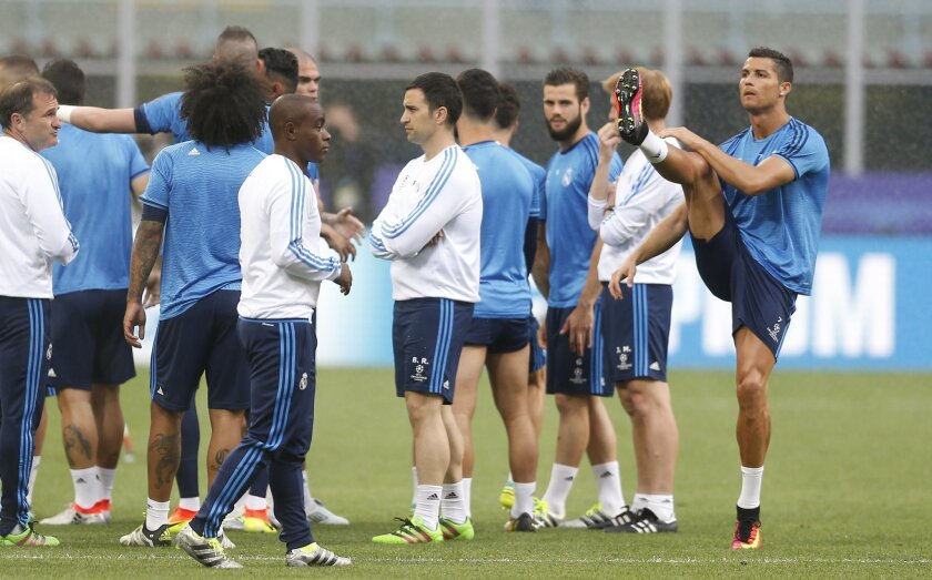 Real Madrid's Cristiano Ronaldo, right, and teammates attend a training session at the San Siro stadium in Milan, Italy, Friday, May 27, 2016. The Champions League final soccer match between Real Madrid and Atletico Madrid will be held at the San Siro stadium on Saturday, May 28. (AP Photo/Manu Fer
