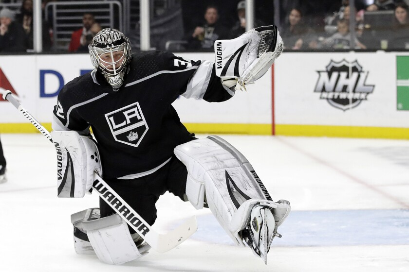 FILE - Los Angeles Kings goaltender Jonathan Quick stops a shot during the third period of an NHL hockey game against the Colorado Avalanche in Los Angeles, in this Monday, March 9, 2020, file photo. Quick is used to being in net for more than 75% of the Kings' games, but that might change this season with trying to play 56 games in a condensed time frame. (AP Photo/Marcio Jose Sanchez, File)