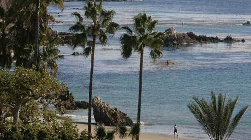 Corona del Mar, once a stretch of isolated oceanfront, has blossomed into a quiet enclave of about 13,000 people.