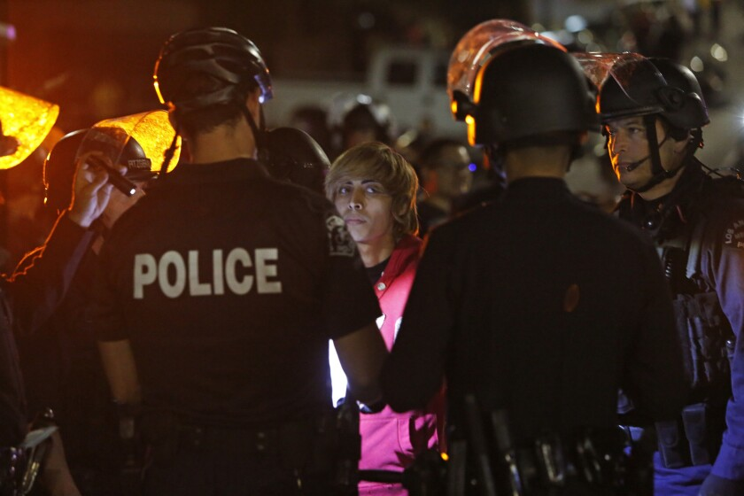 Los Angeles police detain a protester during demonstrations in November 2014 over the grand jury decision on the Michael Brown case.