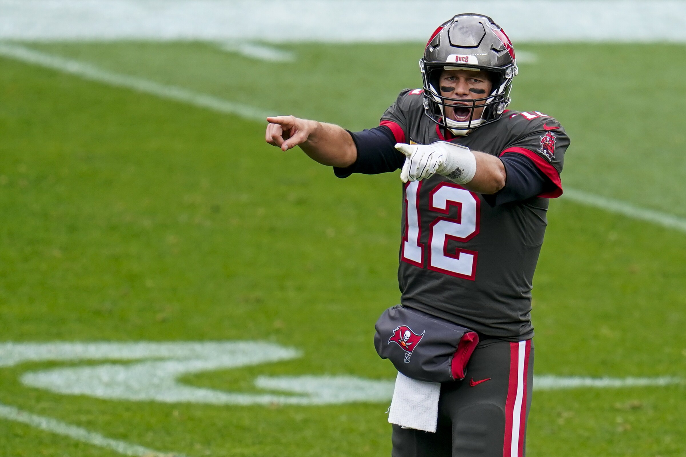 Tampa Bay Buccaneers quarterback Tom Brady signals during a win over the Denver Broncos.
