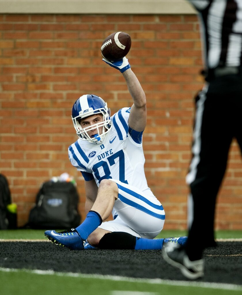 Duke wide receiver Max McCaffrey holds up the ball after scoring a touchdown against Wake Forest during an NCAA college football game in Winston-Salem, N.C. Saturday, Nov. 28, 2015. (Lauren Carroll /The Winston-Salem Journal via AP) MANDATORY CREDIT