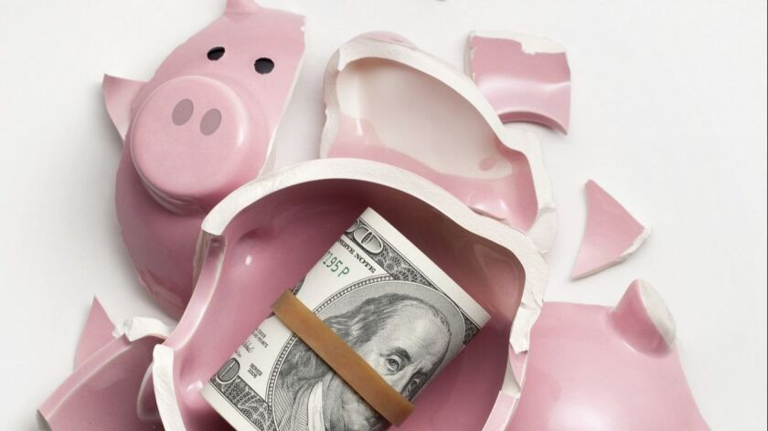 Savings. Broken piggy bank with dollars banknotes
