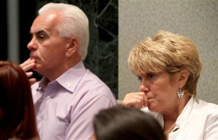 George Anthony, left, and Cindy Anthony, parents of Casey Anthony, listen to Asst. State Attorney Jeff Ashton give the final rebuttal in the Casey Anthony murder trial at the Orange County Courthouse in Orlando, Fla. on Monday, July 4, 2011. Anthony has plead not guilty to first-degree murder in the death of her daughter, Caylee, and could face the death penalty if convicted of that charge. (AP Photo/Red Huber, Pool)