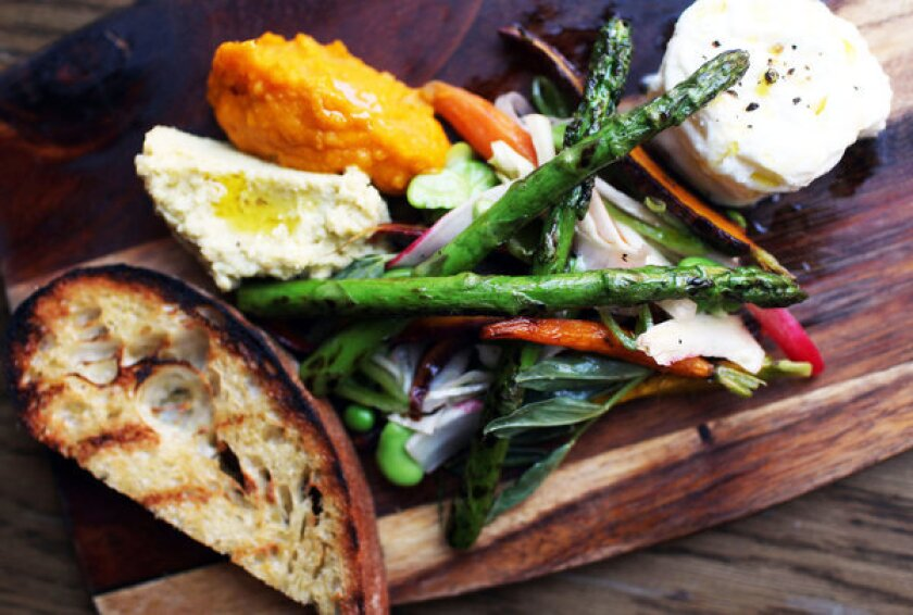 The Farmer's Plate comes with spring vegetables, carrot puree, fava puree, bur rata and grilled toast.