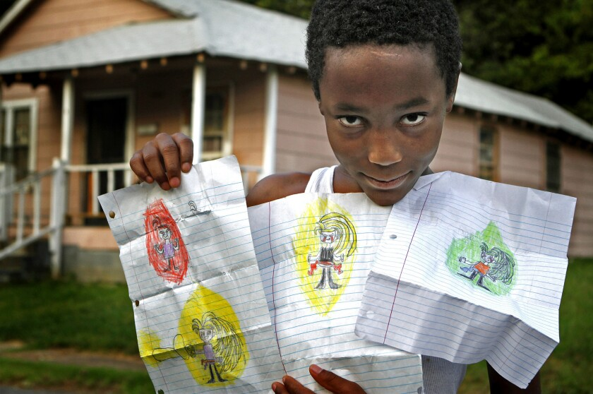 Foster child with his drawings
