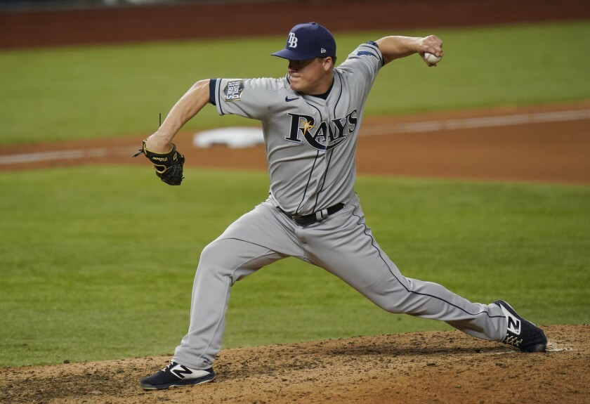 Tampa Bay Rays relief pitcher Aaron Loup throws against the Los Angeles Dodgers during the eighth inning in Game 2 of the baseball World Series Wednesday, Oct. 21, 2020, in Arlington, Texas. (AP Photo/Eric Gay)