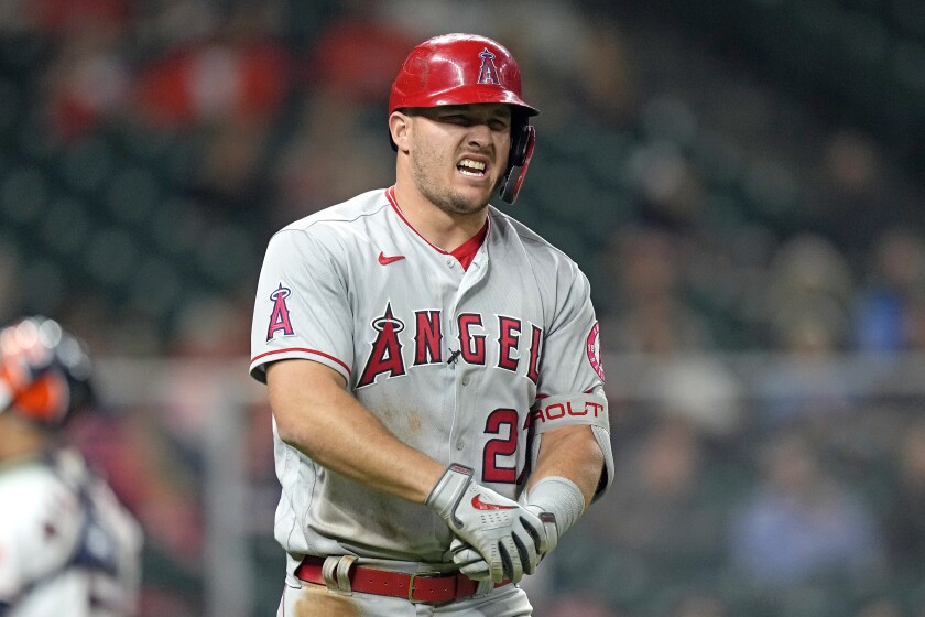 Angels' Mike Trout winces in pain.
