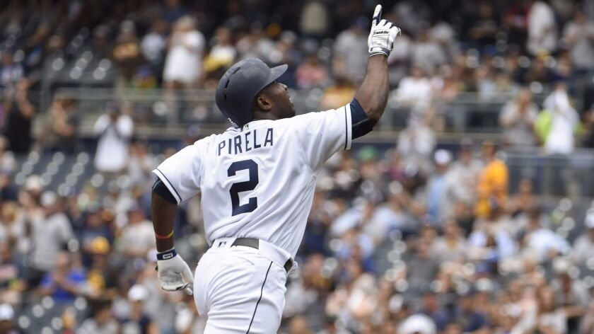 SAN DIEGO, CA - JUNE 10: Jose Pirela #2 of the San Diego Padres points skyward after hitting a solo