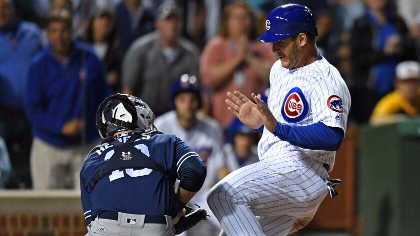 Jun 19, 2017; Chicago, IL, USA; San Diego Padres catcher Austin Hedges (left) tags out Chicago Cubs