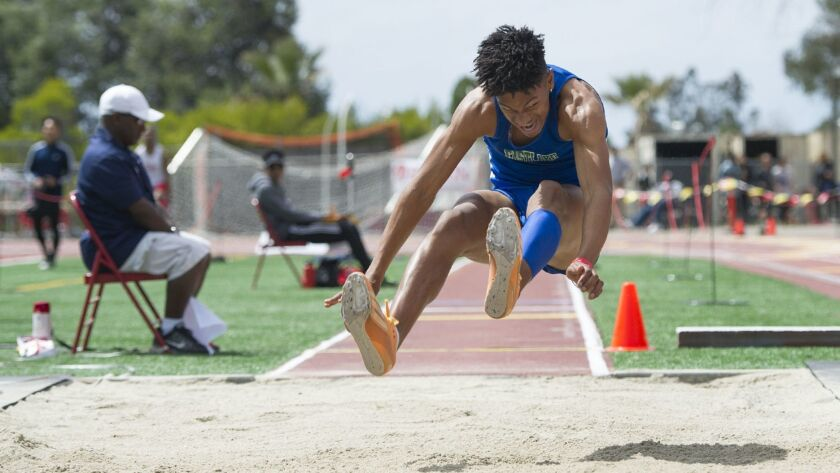 Jalyn Jackson, of Eastlake High School, competes in the Boys Long Jump at the Mt. Carmel Invitationa