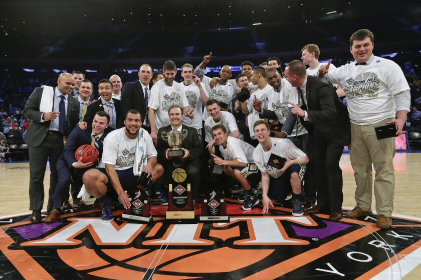 George Washington players celebrate after winning the NIT on Thursday, March 31, 2016, in New York. George Washington defeated Valparaiso 76-60 in the final. (AP Photo/Frank Franklin II)