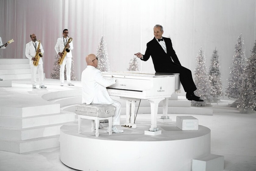 """Bill Murray, right, and Paul Shaffer at the piano in """"A Very Murray Christmas."""""""
