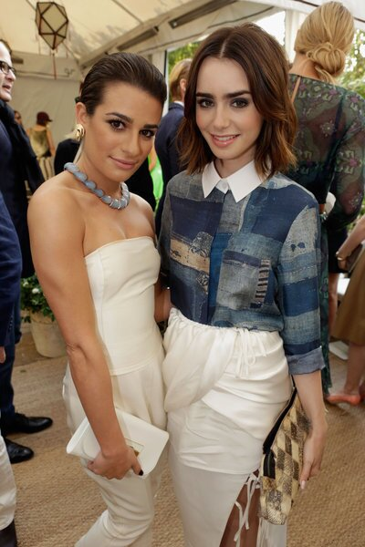 """Actresses Lea Michele, left, and Lily Collins attend the 2013 CFDA/Vogue Fashion Fund event. Collins is wearing Altuzarra's """"Chika"""" boro-printed blouse and """"Pagoda"""" white silk and cupro draped skirt from the spring/summer 2014 collection."""