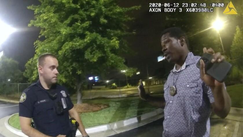 Officer Garrett Rolfe speaking with Rayshard Brooks