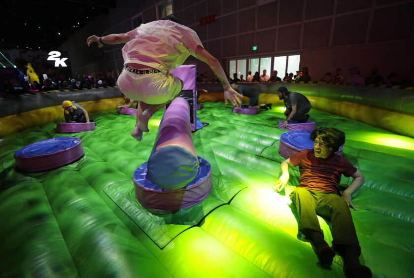 LOS ANGELES, CA -- JUNE 11, 2019: Attendees test their agility and stamina on games at the Fortnite