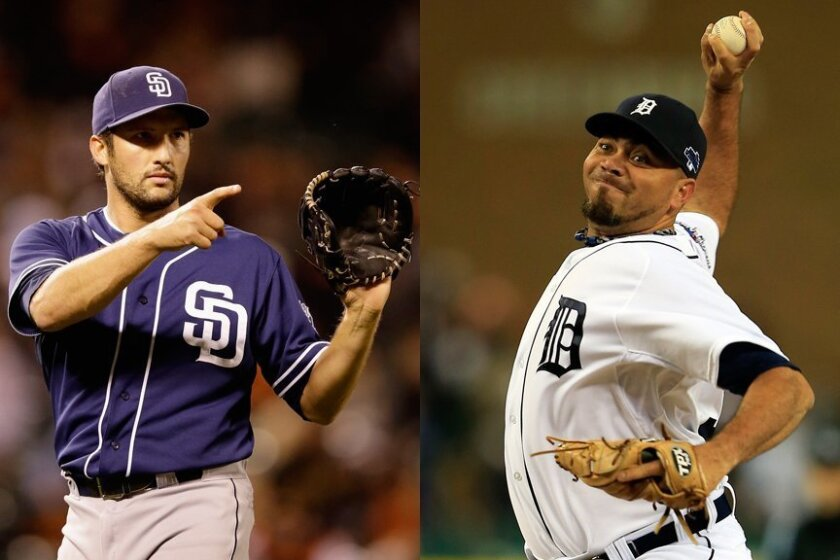 There's no confusing roles as Joaquin Benoit (r) prepares to set up closer Huston Street (l).