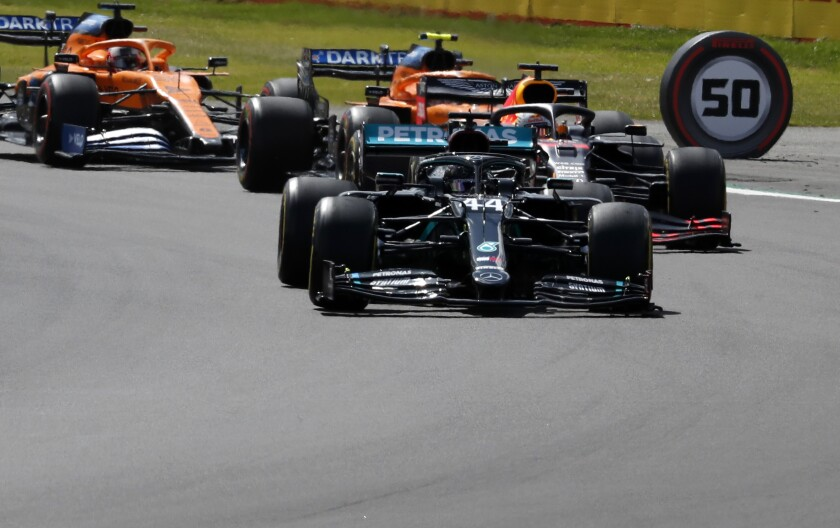 Mercedes driver Lewis Hamilton of Britain steers his car during the British Formula One Grand Prix at the Silverstone racetrack, Silverstone, England, Sunday, Aug. 2, 2020. (AP Photo/Frank Augstein, Pool)