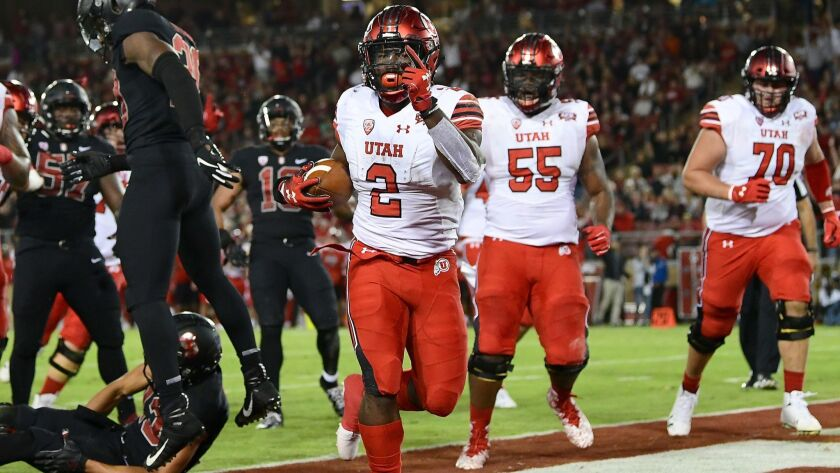 Utah's Zack Moss scores a touchdown against Stanford during the first quarter on Oct. 6.
