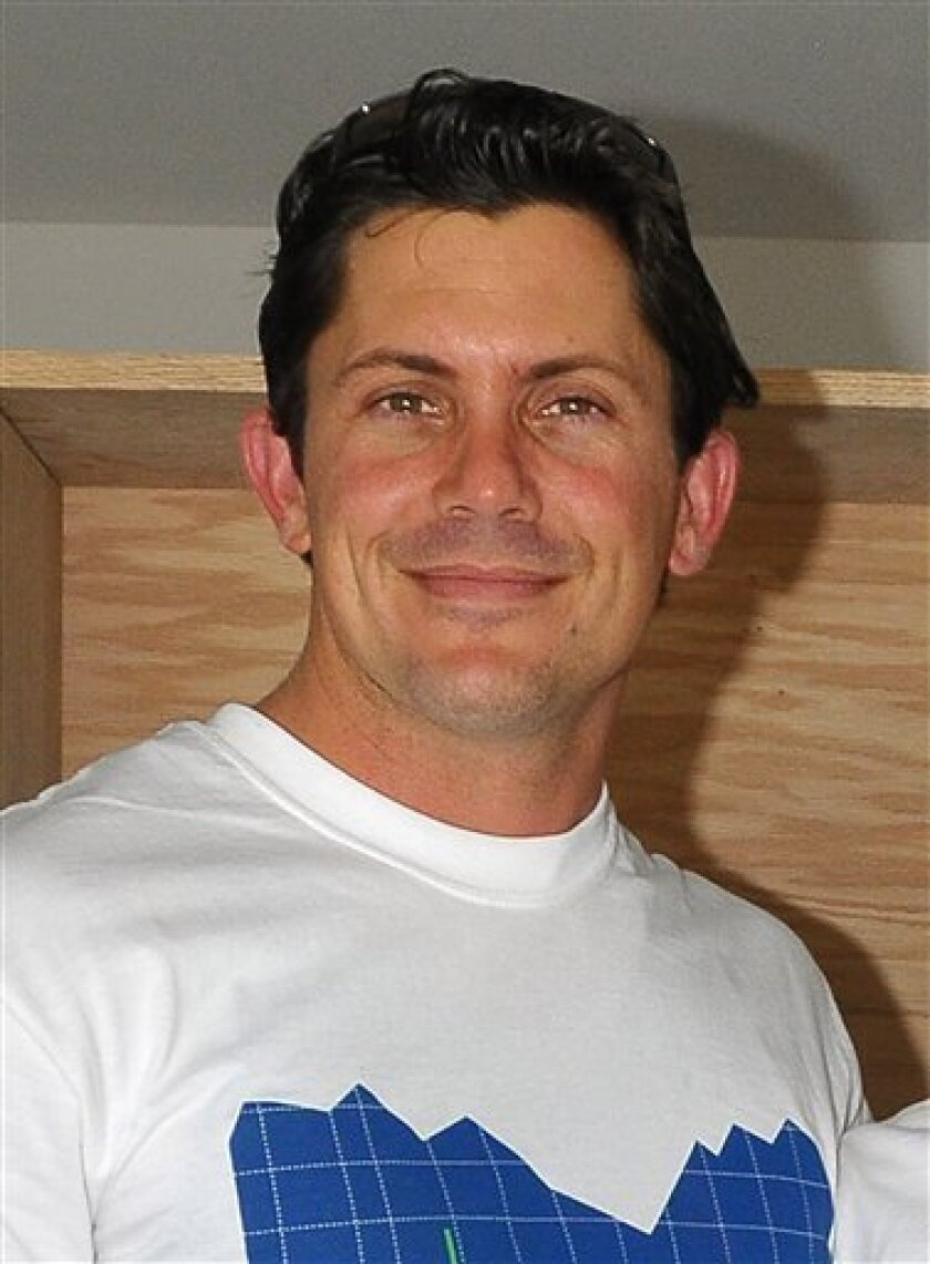 "FILE - In this May 22, 2010 file photo, Julien Hug, a former contestant on the ABC series ""The Bachelorette"" is shown at a Habitat for Humanity event in Pacoima, Ca. KGTV in San Diego says 35-year-old Julien Hug's father Bertrand Hug confirmed Julien's body was found Wednesday, Nov. 3, 2010, in the remote Pinyon Pines area about 90 miles southeast of Los Angeles. (AP Photo/Tammie Arroyo, file)"