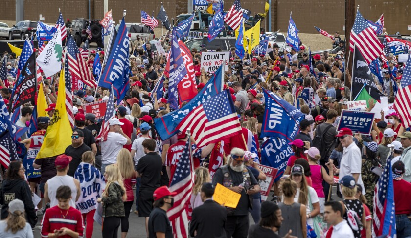 A crowd of about 1,000 Trump supporters gather outside the Maricopa county elections building Friday to protest the results