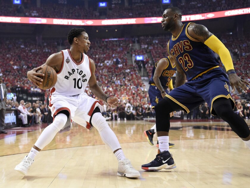 Toronto Raptors guard DeMar DeRozan, left, controls the ball as Cleveland Cavaliers forward LeBron James defends during the first half of Game 6 of the NBA basketball Eastern Conference finals, Friday, May 27, 2016, in Toronto. (Frank Gunn/The Canadian Press via AP)