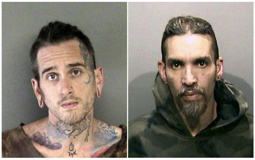 FILE - This combination of June 2017, file booking photos provided by the Alameda County Sheriff's Office shows Max Harris, left, and Derick Almena at Santa Rita Jail in Alameda County.
