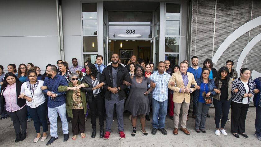 LOS ANGELES, CA - MARCH 7, 2018: Employees of St John's Well Child & Family Center form a human chai