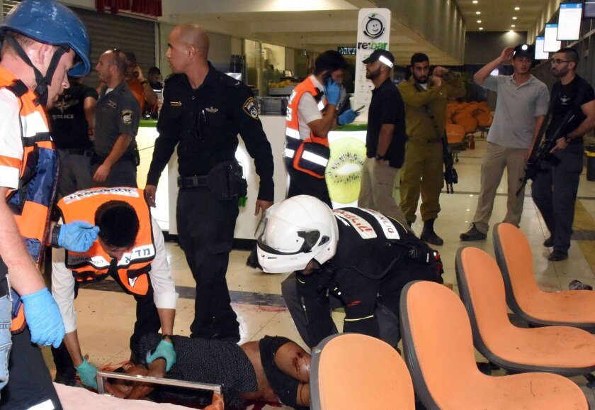 A Eritrean who was shot by an Israeli security guard and then attacked by bystanders who mistook him for an assailant in a deadly attack is evacuated at the main bus station in Beersheba, Israel, on Oct. 18. The man later died of his wounds.