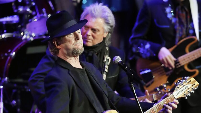 Roger McGuinn, left, of the Byrds, and Marty Stuart perform at the Ryman Auditorium on June 7 in Nashville, Tenn. McGuinn and Byrds co-founder Chris Hillman will tour with Stuart's backing this summer.