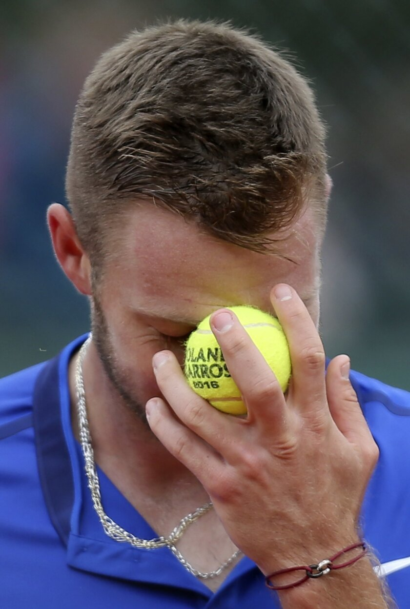 Jack Sock of the U.S. reacts as he plays Germany's Dustin Brown during their second round match of the French Open tennis tournament at the Roland Garros stadium, Wednesday, May 25, 2016 in Paris.  (AP Photo/David Vincent)