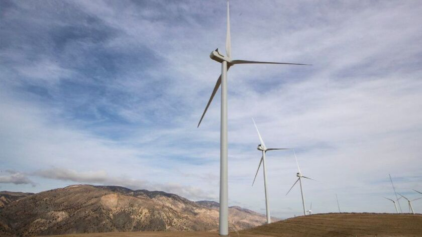 Wind turbines near State Route 58 generate electricity for new energy provider Clean Power Alliance.