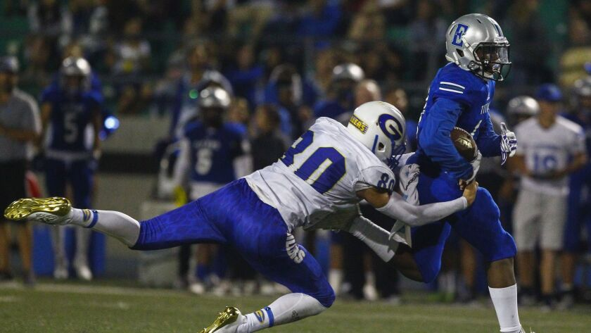 Eastlake wide receiver Claidale Jackson III gets tackled by Grossmont's Danny Yanez in the fourth quarter after making a catch.