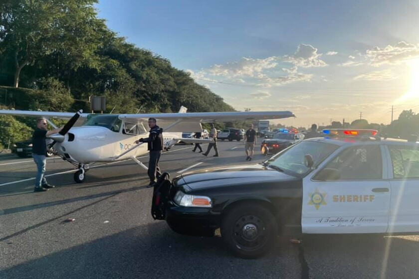 In this photo provided by the Los Angeles County Sheriff's Department, a small plane that made an emergency landing sits on a freeway in Los Angeles on Monday, May 31, 2021. Nobody was hurt when a small plane with two people on board made an emergency landing on a busy freeway at the end of the holiday weekend. The single-engine Cessna landed around 7 p.m. Monday in southbound lanes of State Route 101 in the Westlake Village area, the Los Angeles County Fire Department said. (Los Angeles County Sheriff's Department via AP)