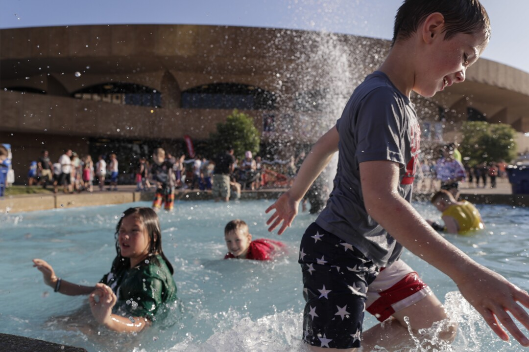 Children frolic in a fountain outside the Century II Performing Arts & Convention Center.