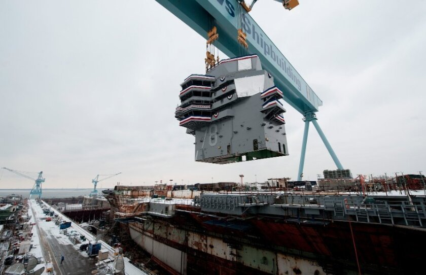 Earlier this year, Huntington Ingalls Industries put the island of the carrier Gerald R. Ford into place at a construction site in Hampton Roads, Virginia.
