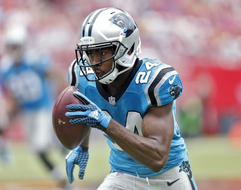 FILE - In this Oct. 4, 2015, file photo, Carolina Panthers cornerback Josh Norman (24) heads for the end zone after intercepting a pass from Tampa Bay Buccaneers quarterback Jameis Winston during the first quarter of an NFL football game in Tampa, Fla. The Panthers have shown versatility, from Cam