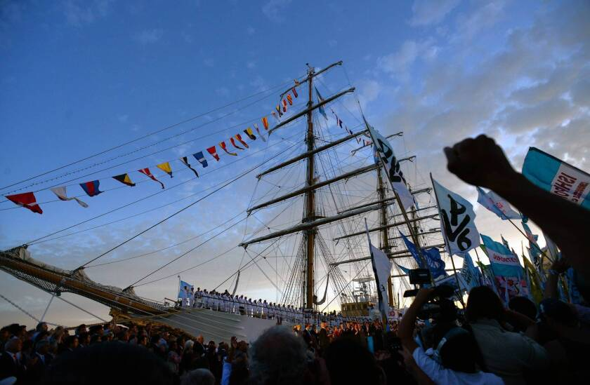 Government supporters attend the arrival of Argentina's frigate Libertad. The ship had been held for two months in Ghana during an attempted seizure by the head of a New York hedge fund.