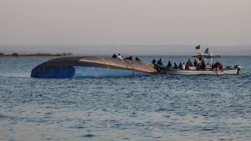 Investigators work on the capsized ferry Nyerere in Lake Victoria, Tanzania, on Sept. 21, 2018.