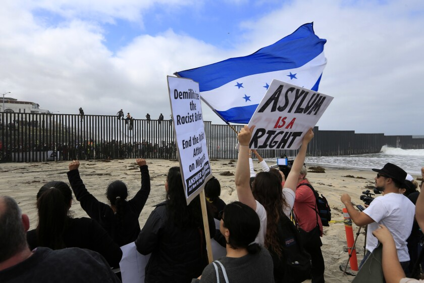 People demonstrate in support of asylum seekers at the border