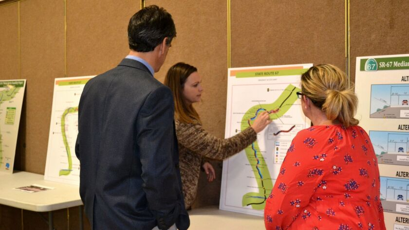 Shawna Schick shows Caltrans District 11 Division Chief Marcelo Peinado driveway access points off SR-67. She and Dixie Labbe, right, support concrete median barriers in sections of the highway.