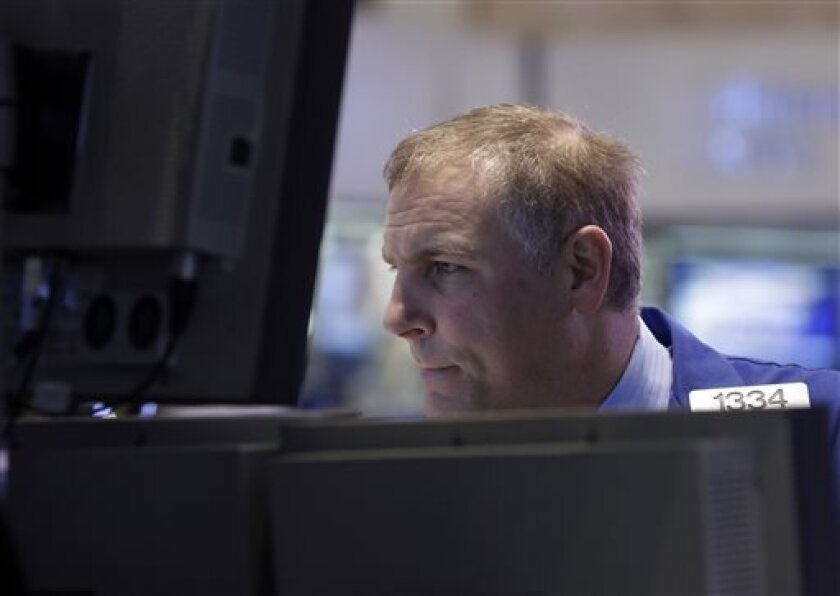 FILE - In this , March 25, 2013, file photo, Specialist Geoffrey Friedman works on the floor of the New York Stock Exchange Monday. Stocks fell in early trading on Wall Street Wednesday, April 3, 3013, after reports on hiring and growth at service companies dampened optimism about the outlook for the U.S. economy. (AP Photo/Richard Drew)
