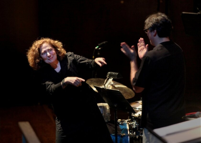 "Julia Wolfe, left, and conductor Julian Wachner after ""Anthracite Fields"" was performed by the Choir of Trinity Wall Street and Bang on a Can All-Stars at Lincoln Center in New York in May 2014."