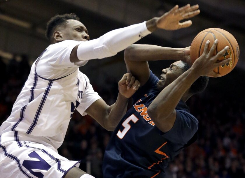 Illinois guard Jalen Coleman-Lands, right, shoots against Northwestern guard/forward Scottie Lindsey during the first half of an NCAA college basketball game on Saturday, Feb. 13, 2016, in Evanston, Ill. (AP Photo/Nam Y. Huh)