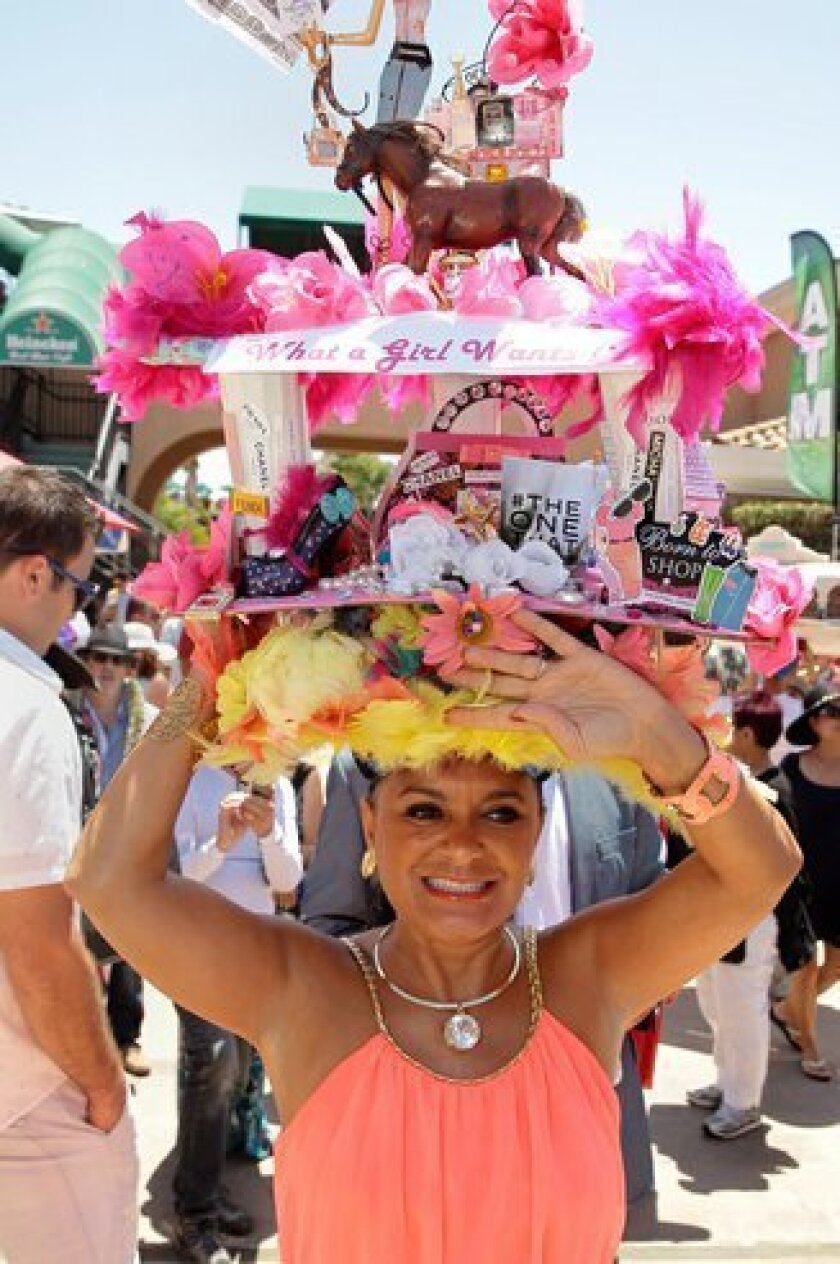 The popular annual Hats Contest will be held again this year on Opening Day July 15. (Above) Adrianna Floyd at last year's event. Photo by Jon Clark