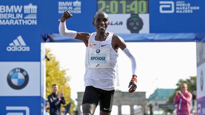 Eliud Kipchoge of Kenya crosses the finish line to win the Berlin Marathon.