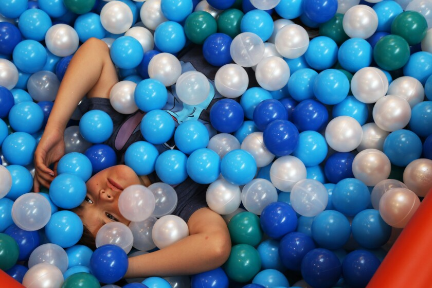 A 9-year-old plays in a Santa Monica ball pit