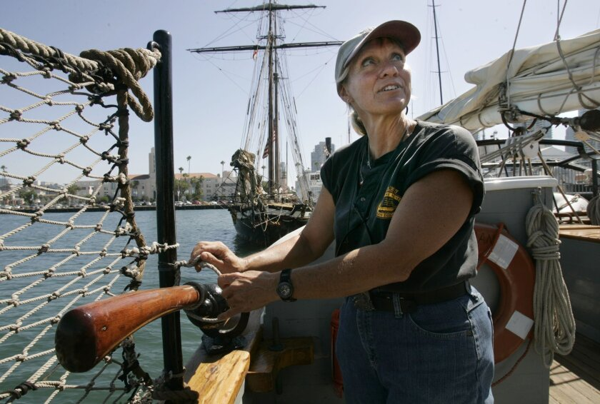 Chari Wessel operated a swing gun on board the Californian yesterday in San Diego Bay. (Peggy Peattie / Union-Tribune)