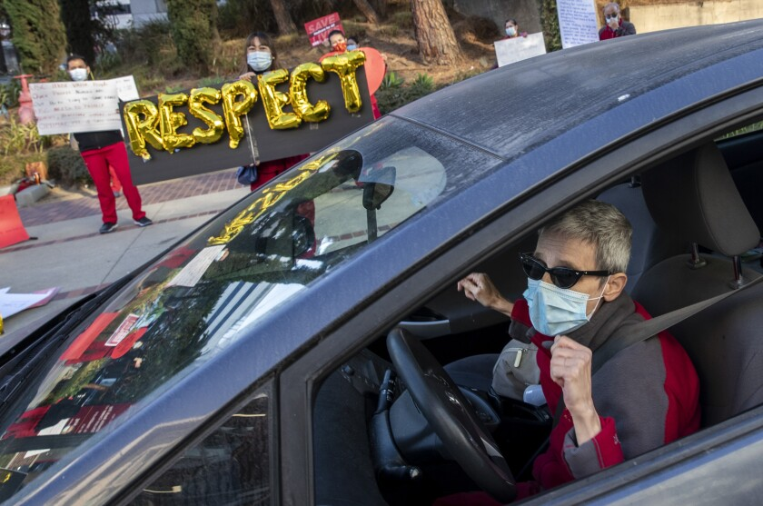 """Nurse Helena Harvilicz dances in her car to  """"Respect"""" at Keck Hospital of USC, where nurses were protesting"""