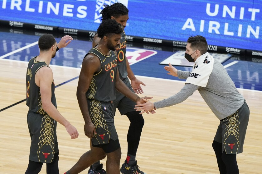 Chicago Bulls forward Patrick Williams (9) celebrates with guards Zach LaVine, left, Coby White and Ryan Arcidiacono after scoring a basket during the second half of an NBA basketball game against the Toronto Raptors in Chicago, Sunday, March 14, 2021. (AP Photo/Nam Y. Huh)